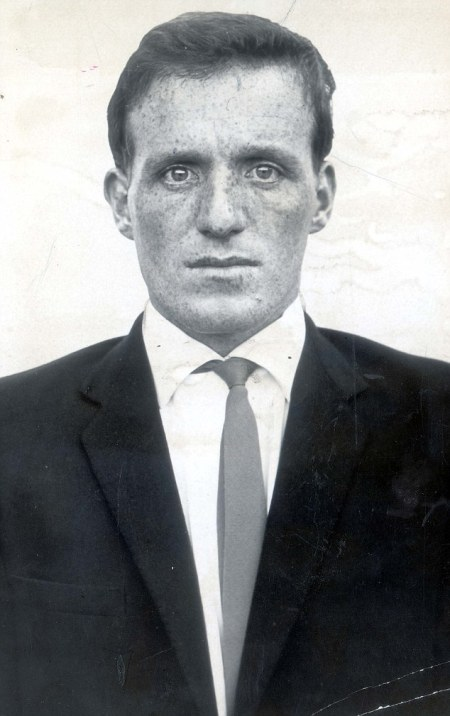 """PKT2228-154416 JAMES HANRATTY 1962 James Hanratty will be escorted from the condemed cell at Bedford Prison today to begin a second fight for his life. """"Ginger Jim"""", 25 year old convicted killer, will walk 75 paces past cells containing the jail's 178 other prisoners, to a distempered interview room. Across a scrubbed oak table he will confer with the members os his legal team who are considering an appeal against his death sentence. Waiting for the report on the prison talks will be Michael Serrard, 34, the defence counsel who almost collapsed in the stuffy, over crowded Shire Hall court room on Saturday night when the 11 man jury pronounced their verdict."""