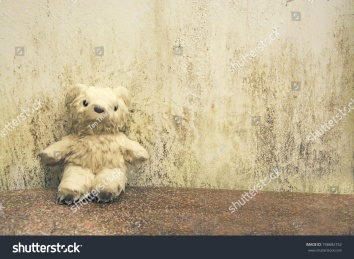 stock-photo-teddy-bear-drenched-on-marble-floor-just-feel-so-empty-vintage-style-748682752